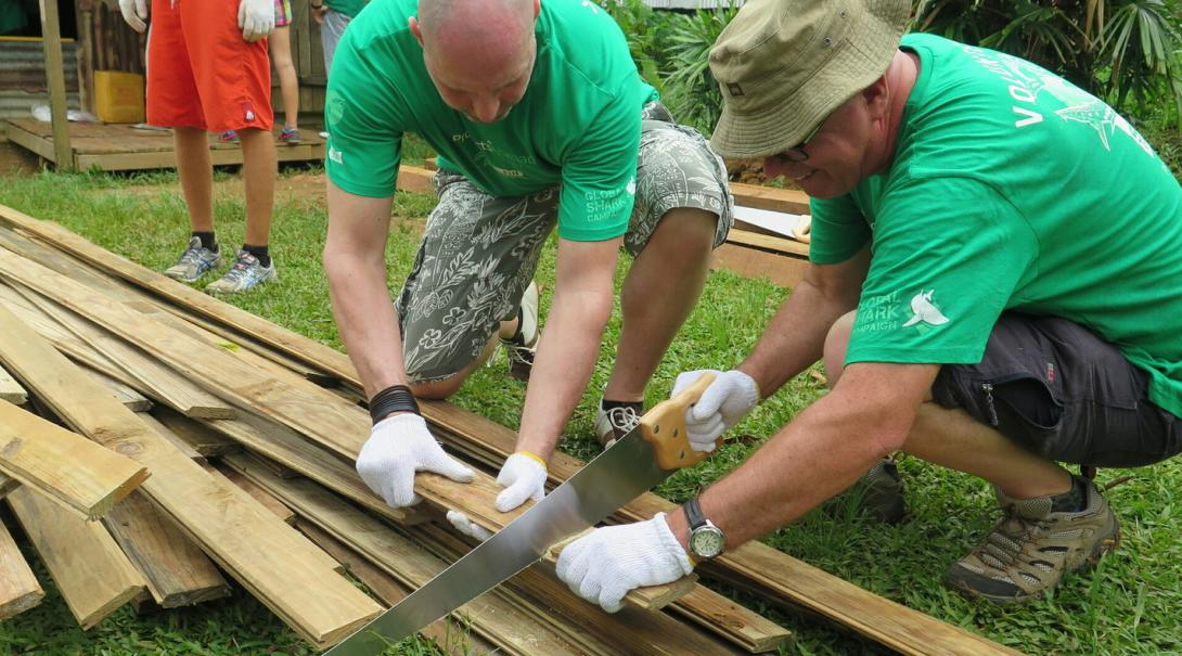 Retired professionals volunteer on a building project in Fiji